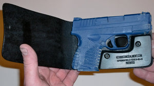 Wallet style top covered back pocket holster for licensed concealed weapon carry of Springfield XDS