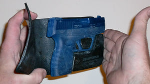 Wallet style top covered back pocket holster for licensed concealed weapon carry of Taurus 709