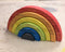Finished Ash & Co. Workshops wooden rainbow with bright oil wood stain colours
