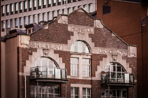 Georges and Co exterior with text on brickwork