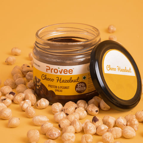 Provee Choco-Hazelnut jar and hazelnuts lying around it