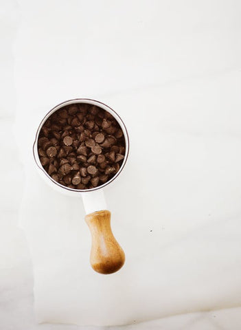 A cup full of dark chocolate chips