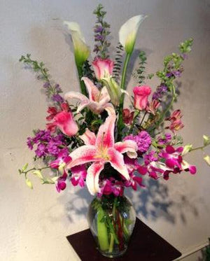 A Spring Mix Signiture with Orchids