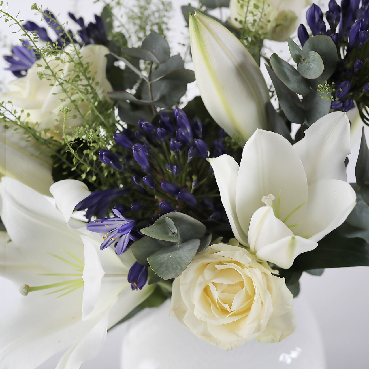 Great Value Flowers A Beautiful Hand Tied Bouquet of Orange Lillies with Free UK DELIVERY and Next Day DELIVERY Available.