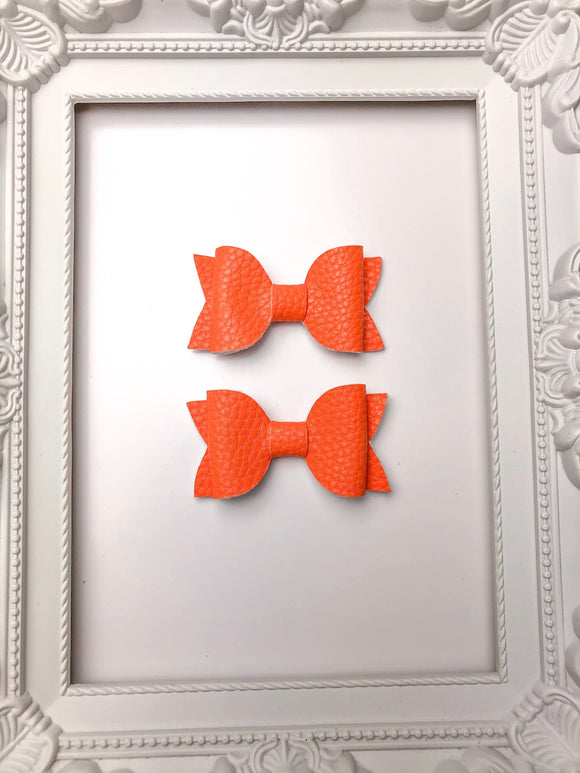 Bright Orange Pig Tail Bows