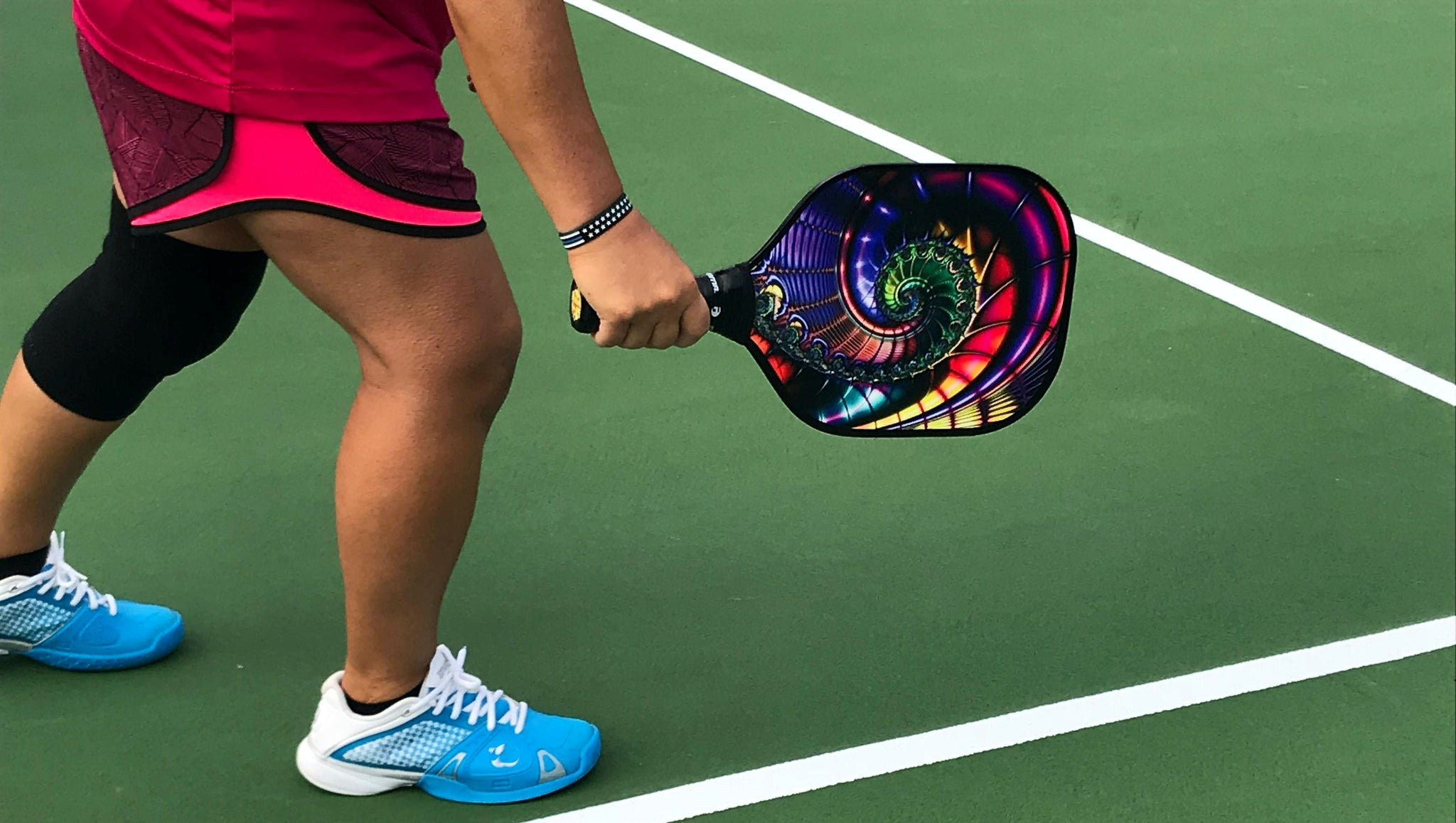 Pickleball racket: player with pickleball racket in hand
