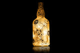 Golden floral bottle lamp