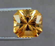 Load image into Gallery viewer, VVS 5.00 Carats Excellent Radiant Cut Orange Topaz from Katlang Mine Pakistan.