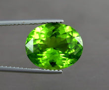 Load image into Gallery viewer, IF 15 Carats Top Quality Perfet Oval Pair Natural Green Peridot from Pakistan.