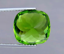 Load image into Gallery viewer, IF 10.50 Carat Green Cushion Shape Natural Peridot from Supat Mine Pakistan.