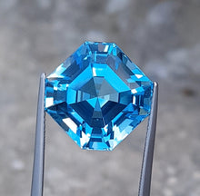 Load image into Gallery viewer, Flawless 21.40 Carats Excellent Asscher Cut Swiss Blue Topaz.