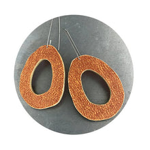 Load image into Gallery viewer, linen texture orange recycled book earrings by christine terrell for ex libris jewelry