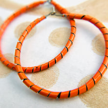 Load image into Gallery viewer, Spiraled Tin Bright Orange Hoop Earrings