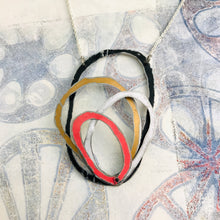 Load image into Gallery viewer, Midnight, Gold, White & Pink Scribbles Upcycled Tin Necklace