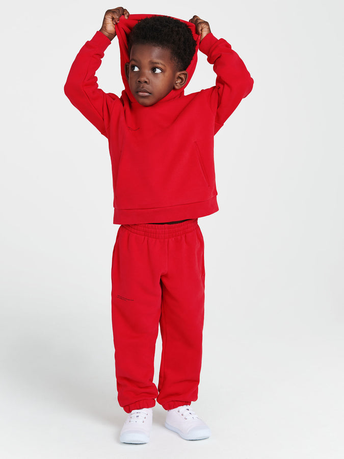Kids organic cotton track pants—apple red