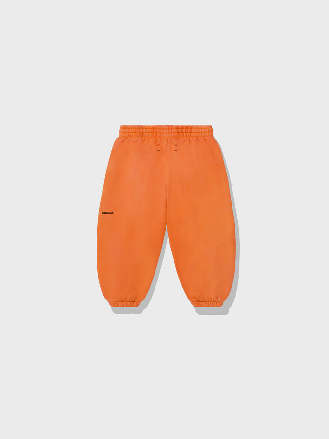 Kids lightweight organic cotton track pants—persimmon orange