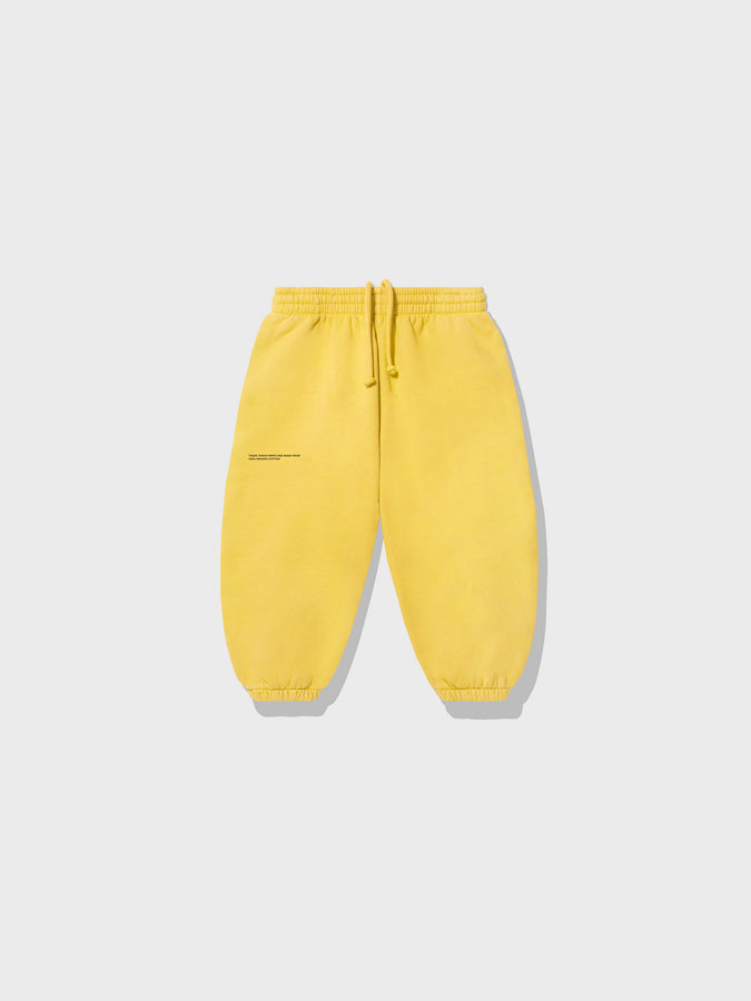 Kids lightweight organic cotton track pants—saffron yellow