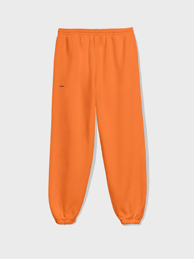 Lightweight recycled cotton track pants—persimmon orange