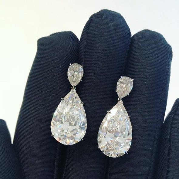 Elegant Pear Cut Lab-created Drop Earrings in 925 Sterling Silver