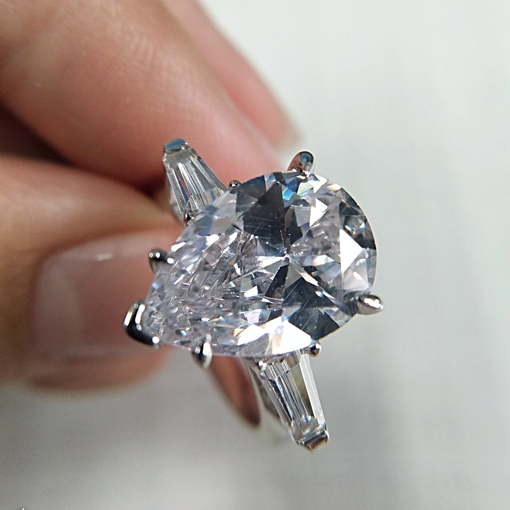 3-Stone Pear Cut Lab-created Sapphire Engagement Ring in 925 Sterling Silver