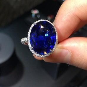 Blue Oval Cut Lab-created Sapphire Halo Engagement Ring in 925 Sterling Silver