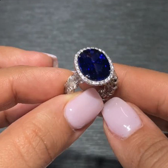Oval Blue Sapphire Engagement Ring with Diamond Halo