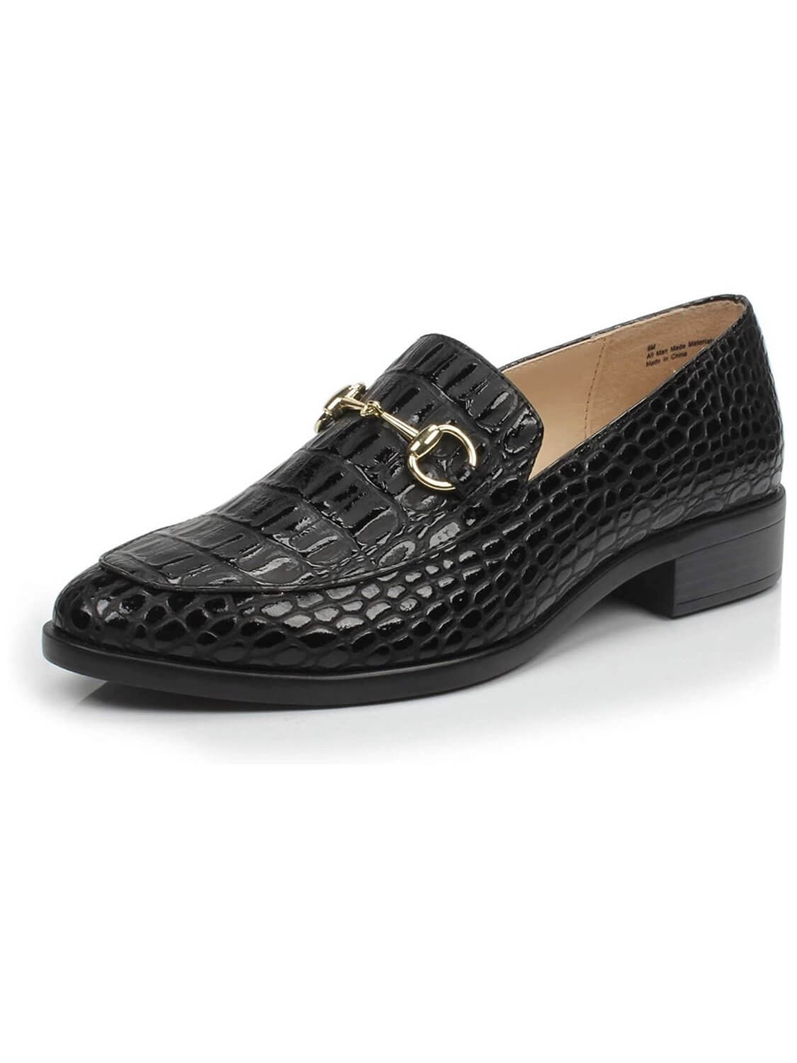 Black loafers of European design, in velvet feeling fabric, rubber sole and gold detail on the front.
