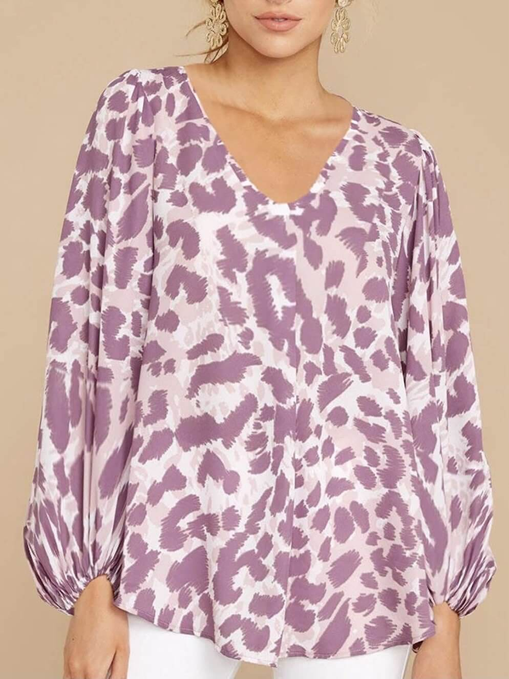 Model is wearing an animal print top. It is a European design with a casual style, beautiful bomber sleeves, a V-neckline and elastic at the wrists.