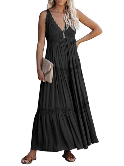 Model wears long black dress without sleeves, V-neckline and lace details accompanied by clutch bag