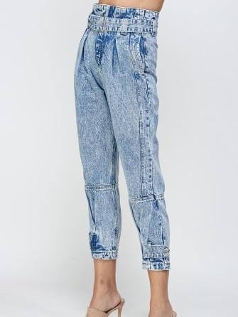 High cut blue jogger jeans with belt and buckle to adjust, zip to close, front pockets and button details on the lower legs.