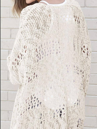 Model shows back of beige knitted sweater