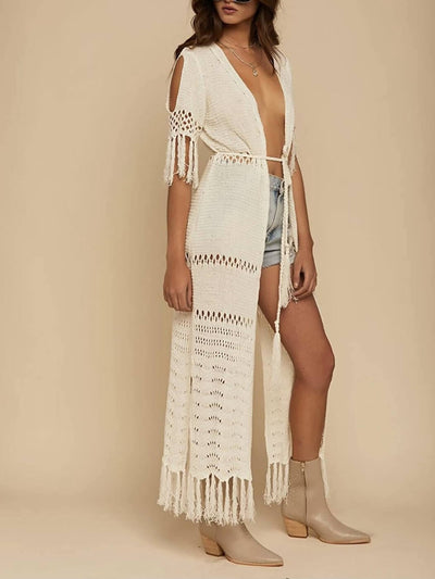 Boho style beige kimono or dress, with short fringed sleeves, open shoulders and legs, adjustable front drawstring.
