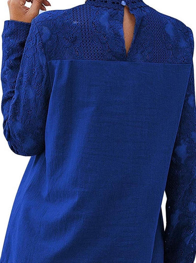 model shows back part of blue long-sleeved shirt, in lace fabric, round neck and button closure
