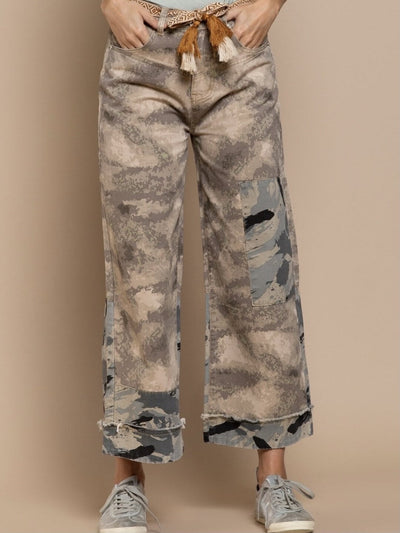 model shows camouflage trousers with relaxed fit, button and zip to close, belt loop, front and back pockets, has a two-tone combination of camouflaged fabric and hem with folded band.