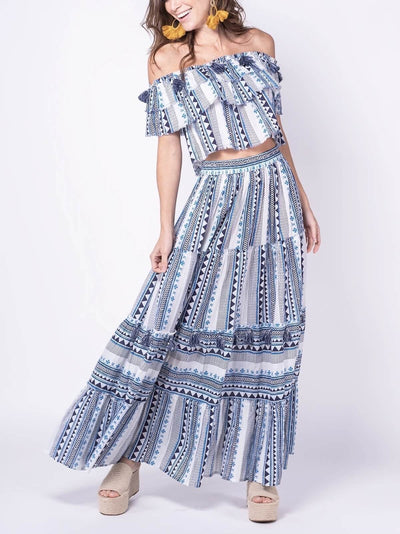 model wears long skirt and blue print top