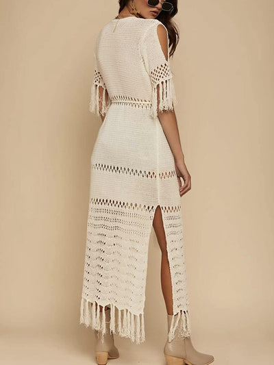 Model shows back of beige boho-style dress or kimono, with short fringed sleeves and open shoulders
