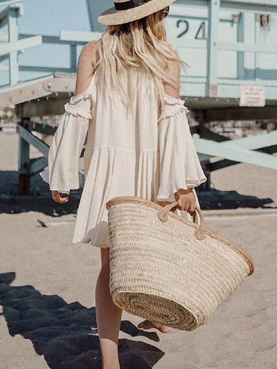 beige layered dress with long sleeves, bare shoulders and ruffle details combined with beach bag and hat