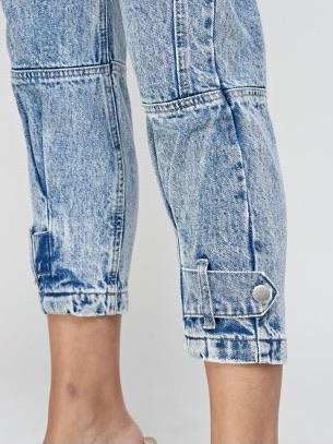 button details on the lower legs of blue Jeans jogger