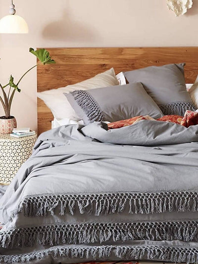 The bed in the room is decorated with a Boho Gray duvet, it has two pillowcases and a duvet cover.
