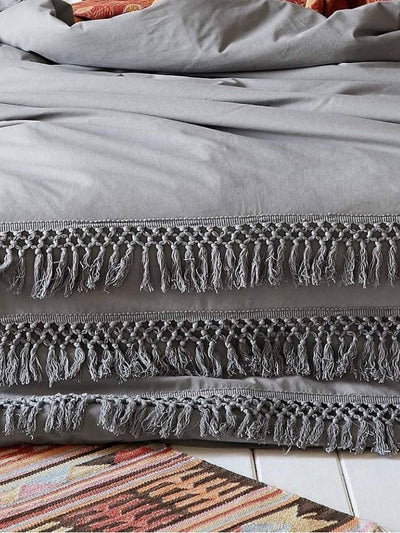 gray boho quilt with tassels