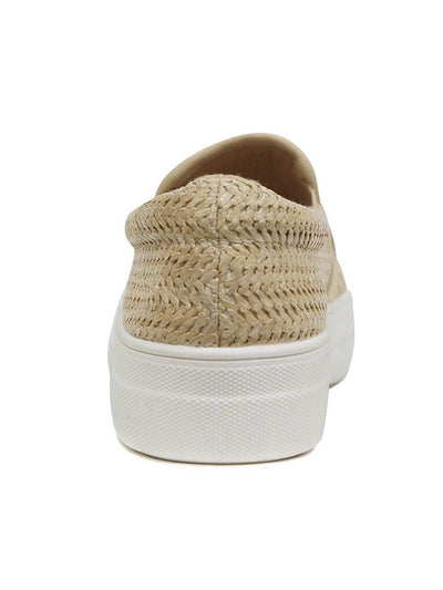 back of beige slip-on sneakers and white rubber sole