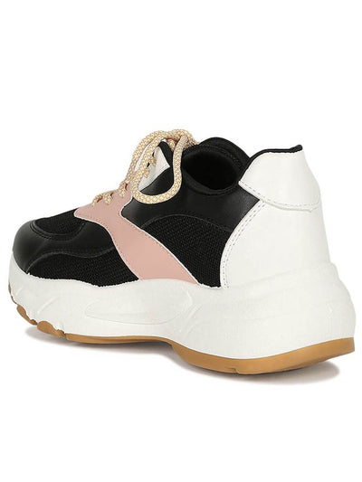 Black, pink and white back of the sneaker, with platform, rubber sole, laces and made of leatherette.