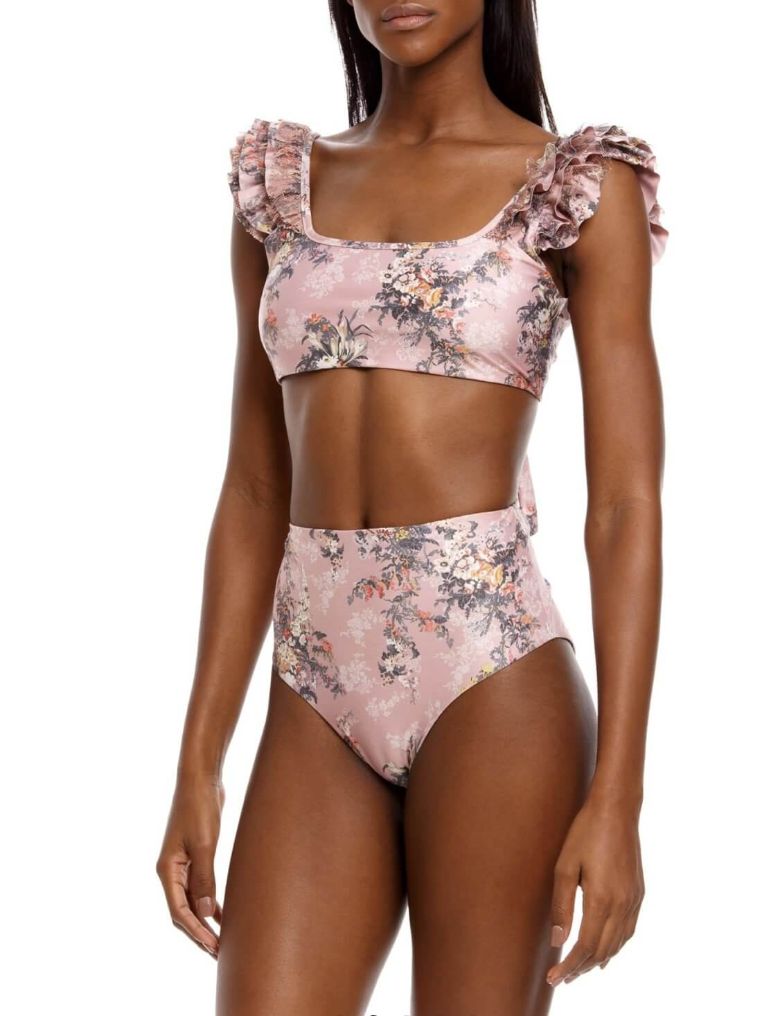 Two-piece swimsuit from Agua Bendita Papier Arielle Top / Papier Alicia Bottom. Made of floral print fabric with lace on the shoulders and high cut bikini.
