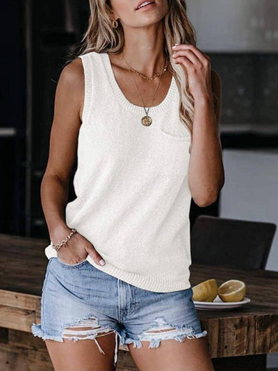 Model wears a beige tank top, round neck, loose fit and front pocket combined with short jeans