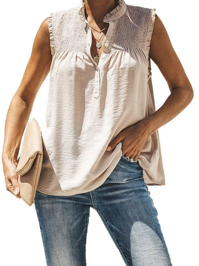 Model shows beige top, sleeveless, with ruffle details on the top front and front button closure