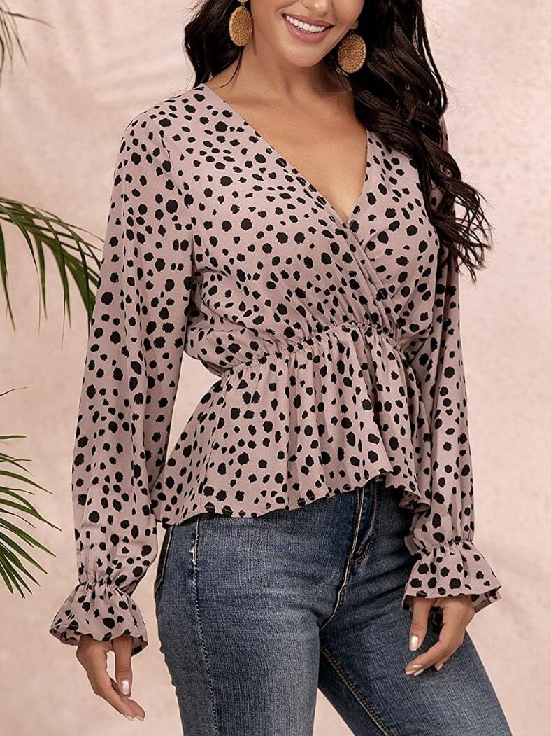 Model wears top with casual animal print, V-neckline, long and wide sleeves, elastic waist and sleeves.