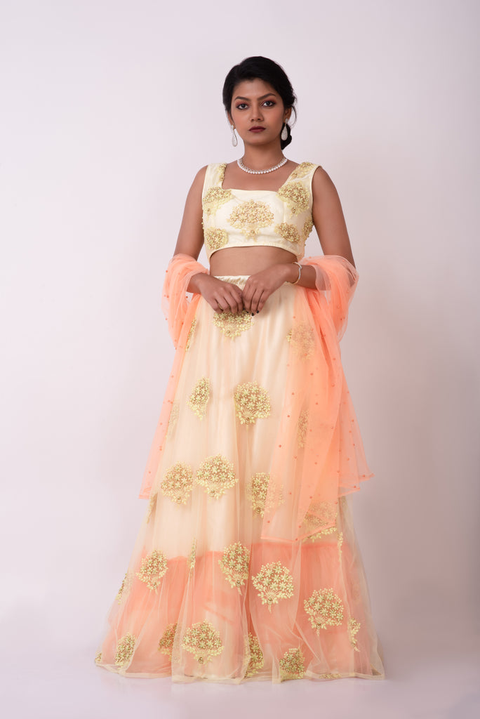Lemon yellow net embroidered lehenga with pleated belt