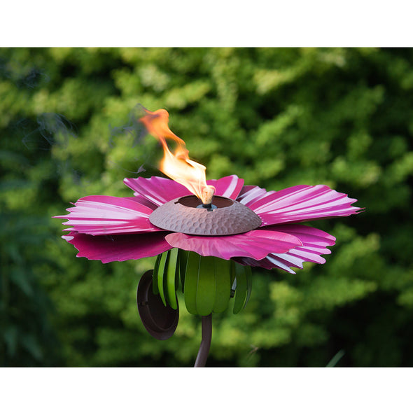Pink Cosmos Torch, lit, with outdoor green background