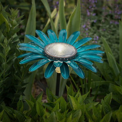 Teal Daisy Solar Light, lit in garden