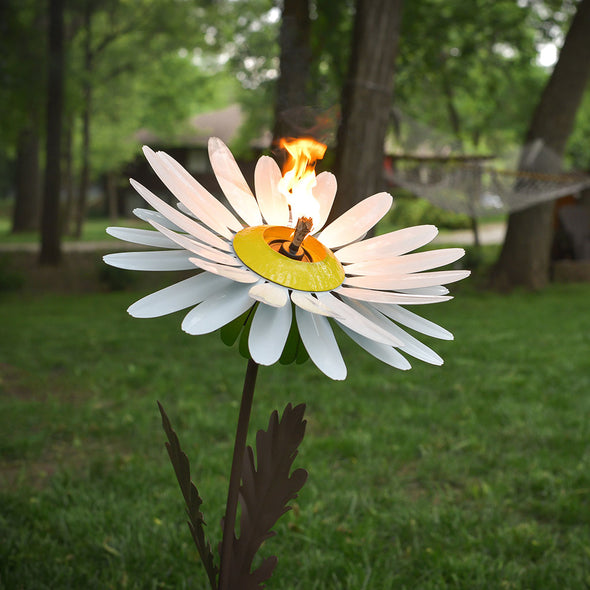 White Daisy Torch lit up in back yard